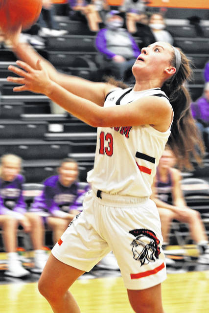 Arcanum's Madelyn Fearon scores for the Lady Trojans in Arcanum's season opening win over Fort Recovery.