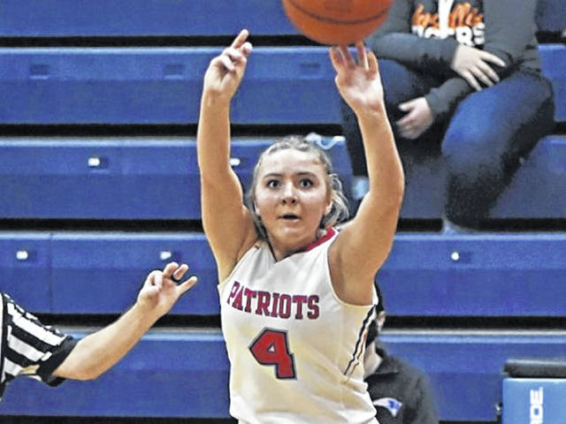 Rylee Sagester drills a three-pointer for Tri-Village in the Lady Patriots 80-42 win over the Versailles Lady Tigers.