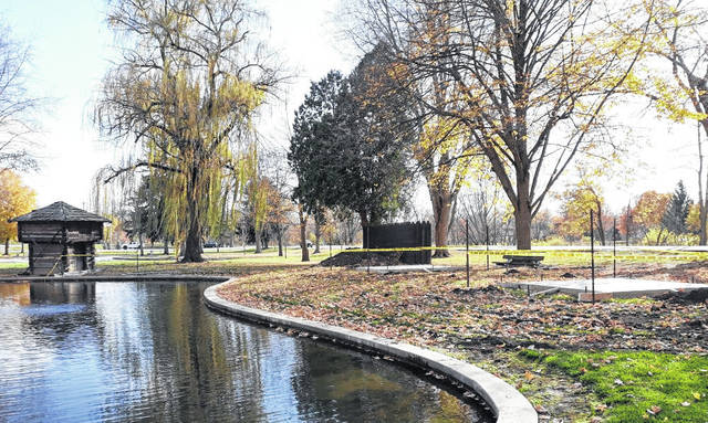 A replica stockade (left) awaits its transfer to a new foundation at the picturesque Greenville City Park.