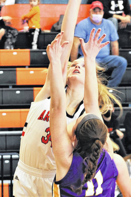 Taylor Gray goes strong to the basket for Arcanum in the Lady Trojans Saturday win over the visiting Eaton Lady Eagles.