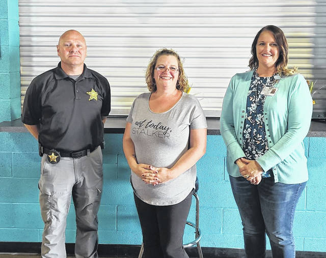 Damsel in Defense DamselPro Shannon Denniston (center) with Darke County Sheriff's Deputy, Det. Doug Didier (left) and Darke County Recovery Services Clinical Director, Vicky Martin (right).