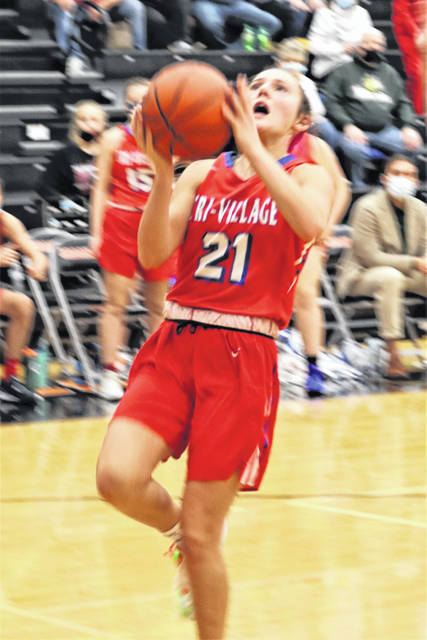 Torie Richards drives the lane for Tri-Village in the Lady Patriots CCC win over Arcanum.