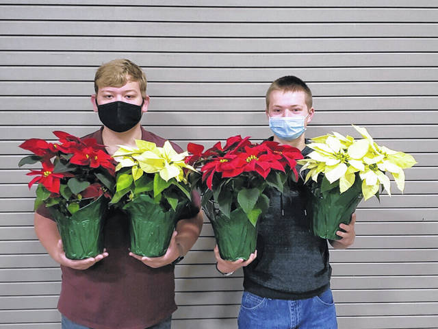 The Franklin Monroe MVCTC FFA chapter is selling poinsettias for Christmas. Shown are FFA members Zach Garber (left) and Mitchell Schmitmeyer (right).