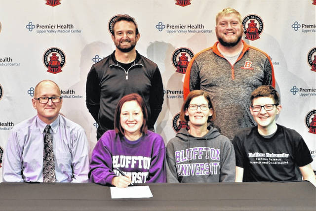The Bradford Lady Railroaders Olivia Daugherty signs to run cross country for Bluffton University. (Front L-R) Bob Daugherty (father), Olivia Daugherty, Sarah Daugherty (mother) andLogan Daugherty (brother) (Back L-R) Rob Grillot (XC Head Coach), Brian Schwieterman (Head Track Coach)