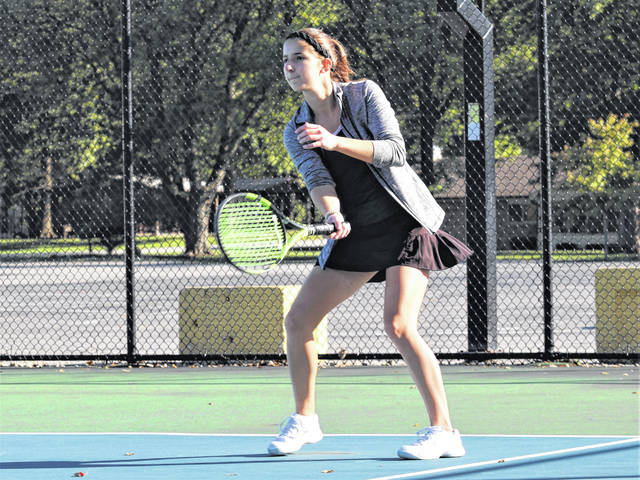 Lady Wave Emily Marchal earns a win for Greenville on a cold and windy spring day.