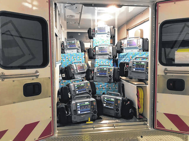 Spirit Medical Transport surprised its employees with new vehicles and equipment. Shown are 10 Lifepak 15 heart monitors revealed to those attending the company party virtually or by watching from inside their cars.