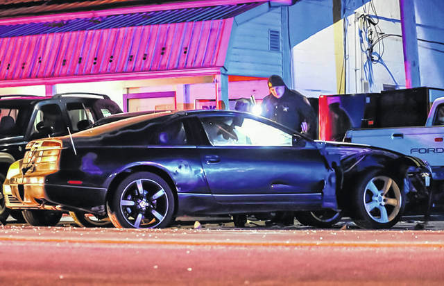 Two people were treated for injuries following a two-vehicle crash near Greenville Monday.