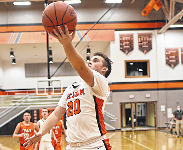 Chad Pitzer drives the lane for Arcanum in the Trojans major victory over National Trail.