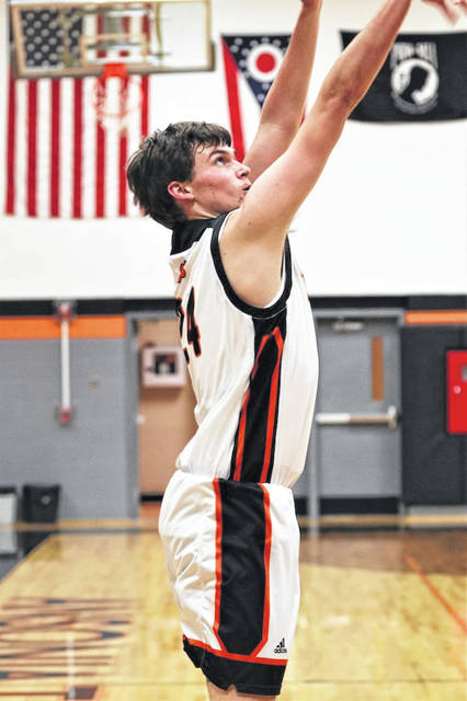 Ethan Hemmerich drills a three pointer in Ansonia's CCC win over Newton.