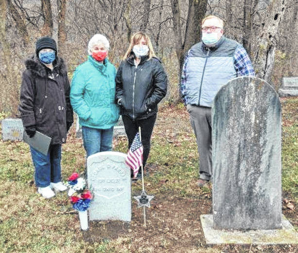 Fort GreeneVille DAR members Caroline Petitjean, Helen Wright, and Debbie Nisonger, with Greenville Union Cemetery Supervisor Tracy Tryon, marking the gravesite of Civil War veteran George D. Farrar.