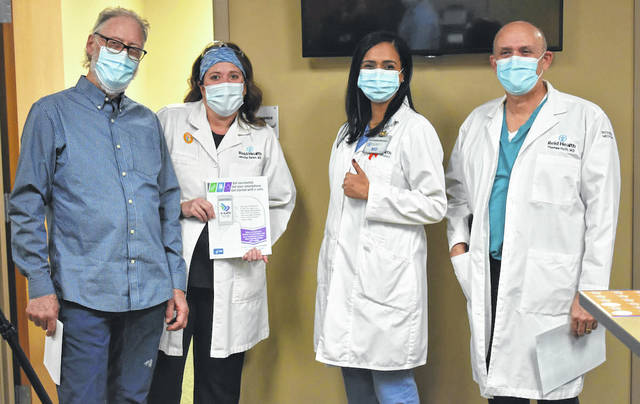 Dr. David Jetmore (from left), Dr. Jennifer Bales, Dr. Annuradha Bhandari and Dr. Thomas Huth were the first to receive the COVID-19 vaccine at Reid Health.