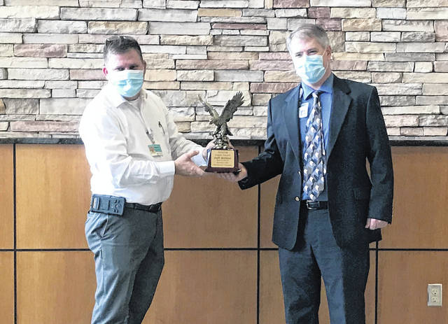 Ray Thies (left), of OSHFM, presents the 2020 Eagle Award to Jeff Subler (right), Vice President of Support Services at Wayne HealthCare.