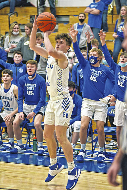 Jace Byers launches a shot for Franklin Monroe in the team's CCC win over the Covington Buccaneers.