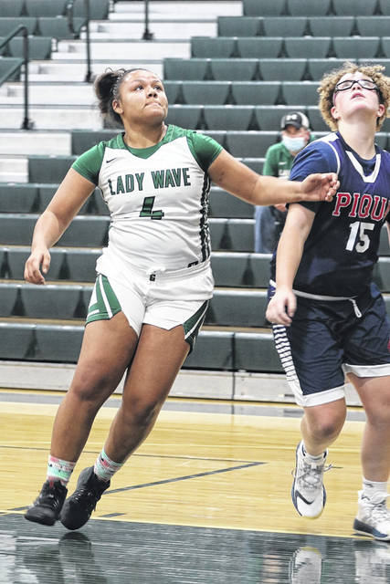 Greenville's Nyisha Wright positions for a rebound in the Lady Wave's win over the Lady Indians.
