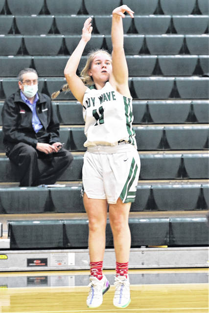 Greenville's Skylar Fletcher hits a 3-pointer in MVL contest with West Carrollton.