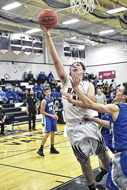 Wyatt Feltner scores 2 of his 22 points to lead all scorers in Mississinawa Valley's in CCC matchup with Miami East.