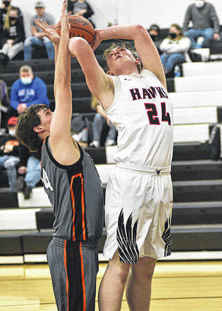 Mississinawa's Zach Conner scores two of his 11 points in the Hawks win over the Ansonia Tigers.
