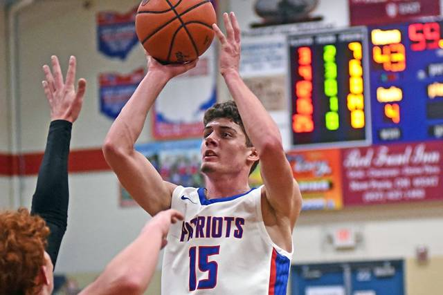 Layne Sarver score 2 of his game high 20 points to lead Tri-Village to a CCC win over Ansonia.