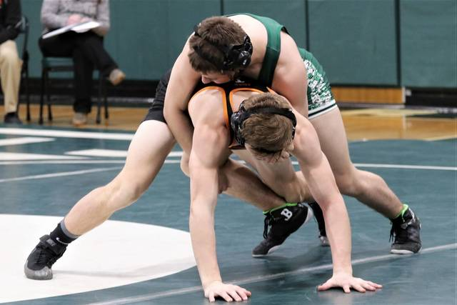 Greenville and Arcanum wrestlers meet on the matt in Tuesday night non-conference wrestling match.
