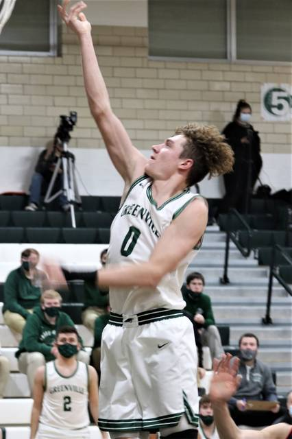 Alex Baumgardner goes strong to the basket for the Wave in the team's matchup with Tippecanoe.