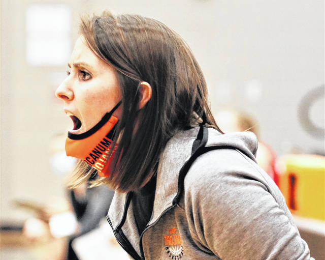 Arcanum Lady Trojans basketball coach Abbey Moore encourages her team in Cross County Conference action.