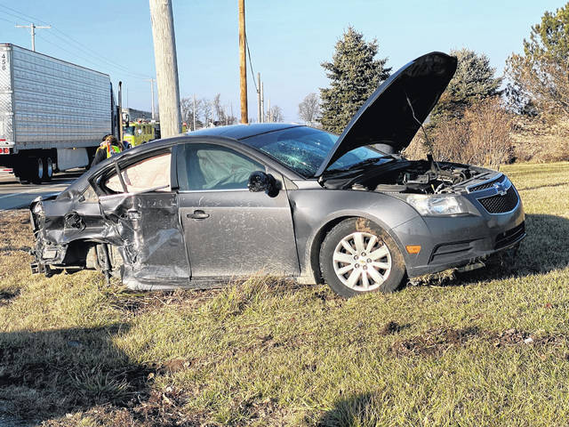An Arcanum teen was treated for injuries after his vehicle pulled into the path of a semi tractor-trailer on Saturday.