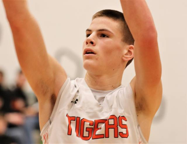 """Versailles 6'5"""" Connor Stonebraker hits a free throw to go a perfect 8-8 at the line and lead all scorers with a game high 24 points in the Tigers win over Bellefontaine."""