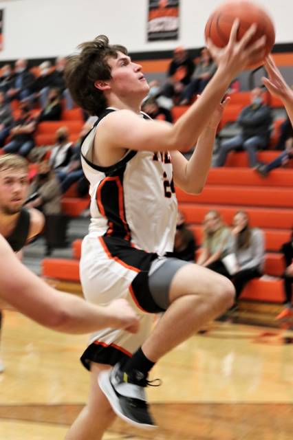 Ansonia's Ethan Hemmerich drives for a score in the Tigers win over the TVS Panthers.