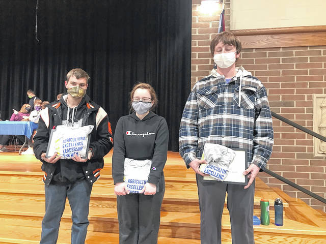 Greg Dircksen, Chole Grillot and Jason Mescher were named January Members of the Month for Versailles FFA.