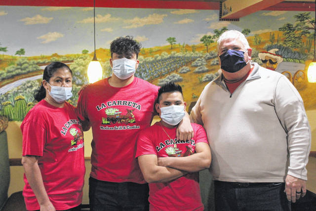 Shown from left to right: Owner Isabel Delgado, Owner/Manager Eduardo Delgado, employee Lukas Tadeo, and former Fairlawn owner Pat Foley.