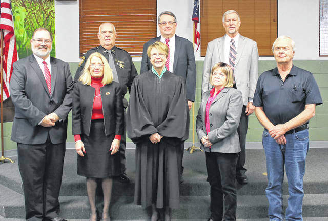 Front row (L to R): County Commissioner Matt Aultman, Clerk of Courts Cindy Pike, Ohio Supreme Court Justice Sharon L. Kennedy, County Recorder Linda Stachler, and County Engineer Jim Surber. Back row (L to R): Sheriff Toby Spencer, County Prosecutor R. Kelly Ormsby, and County Coroner Timothy Kathman. Not pictured, but present at the event, County Treasurer Scott Zumbrink.