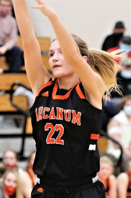 Kaitlyn Toy nails a 3-pointer for Arcanum in the Lady Trojans Cross County Conference win over Bradford.