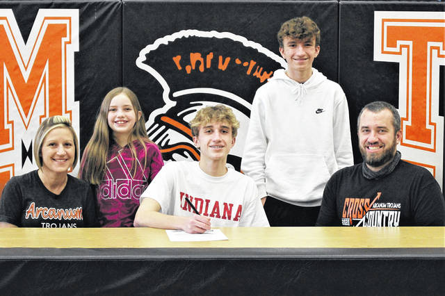 Arcanum's Logan Todd signs to run indoor and outdoor track and cross country for IU East. (Front L-R) Pamela Todd (mother), Todd and Jason Todd (father). (Back L-R) Chloe Todd (sister) and Mason Todd (brother).