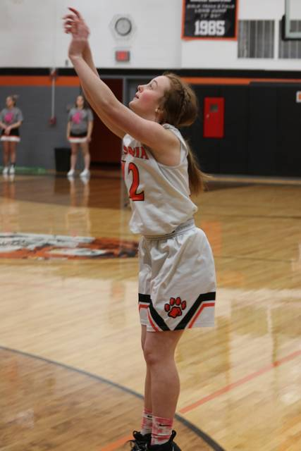 Maddie Buckingham puts up an Ansonia shot in the team's win over the Lady Hawks.