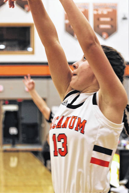 Madelyn Fearon burries her record setting single game seventh 3-pointer in leading Arcanum to a single game 3-point Lady Trojans team record 16 treys in the team's 74-12 win over Tri-County North.