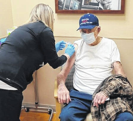 Pictured are Emily Hoisington, BSN, RN administering a dose of vaccine to a Darke County resident. The Darke County General Health District has partnered with Family Health, Wayne HealthCare, and Reid Hospital to get the COVID-19 vaccine out to the residents of Darke County.