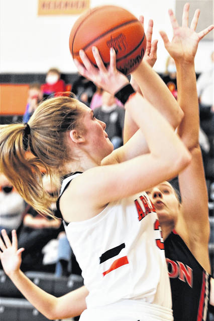 Arcanum's Taylor Gray scores 2 of her 16 points in the Lady Trojans win over Milton-Union.