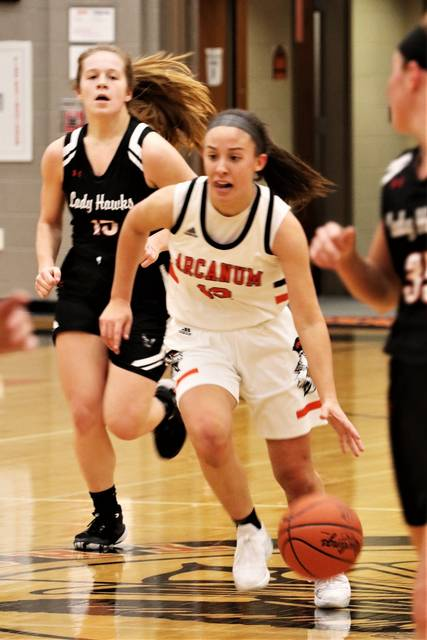 Madelyn Fearon races the ball upcourt for Arcanum in the Lady Trojans CCC win over MV.