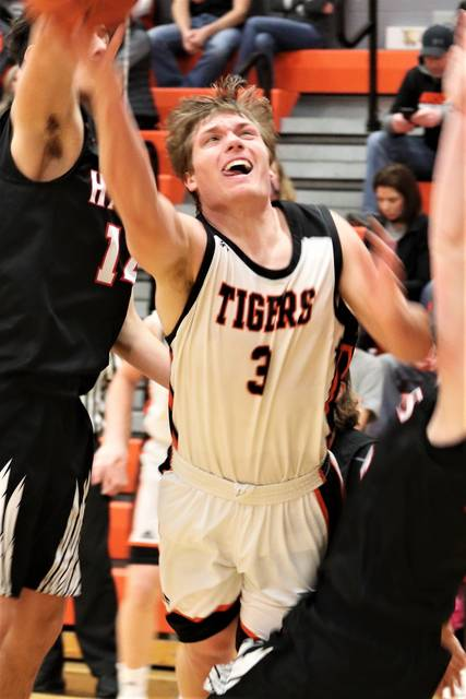 Ansonia's Reece Stammen drives to the basket to score 2 of his game high 13 points in the Tigers win over Mississinawa Valley.