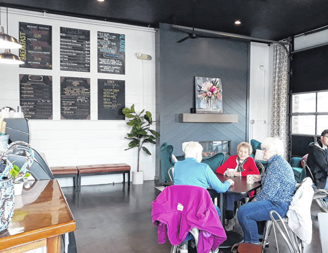 Patrons enjoy the inviting atmosphere, well-spaced dining area, and warm reception at Midmark's new Gus's Café, located at 16 Marker Road in Versailles, which reopened to the public Monday. Gus's Café is open Monday through Friday, 6 a.m. to 2 p.m.