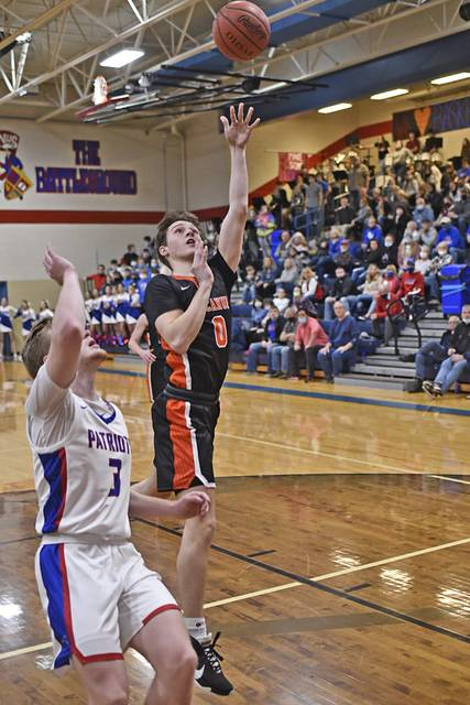 Jake Goubeaux scores for Arcanum in Cross County Conference matchup at Tri-Village.