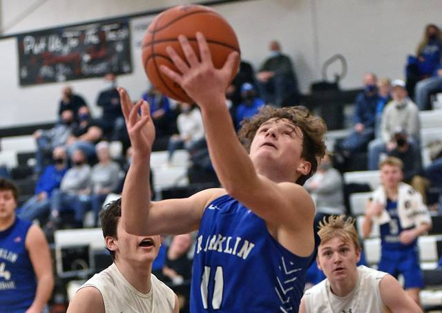 Jayce Byers score 2 of his game high 21 points for Franklin Monroe in the Jets win over Mississinawa Valley.
