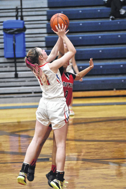 Morgan Hunt scores 2 of her game high 32 points to lead Tri-Village in a big win over the Trotwood-Madison Lady Rams.