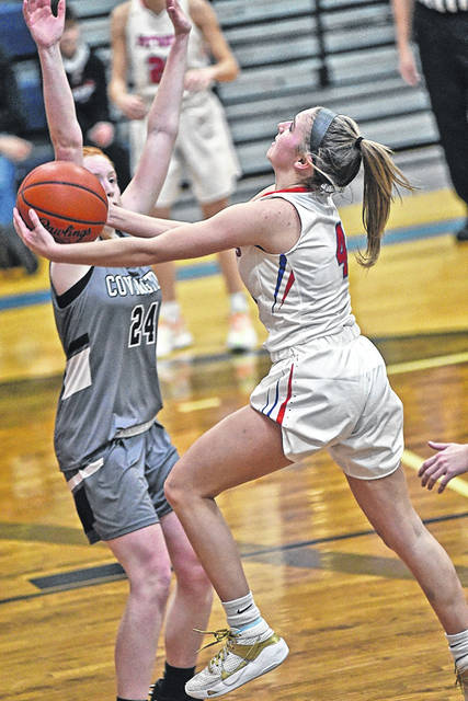 Rylee Sagester scores 2 of her 24 Lady Patriots points to lead all scorer in Tri-Villages win over the Covington Lady Buccaneers.