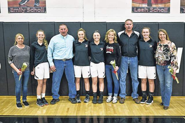 The Lady Blackhawks seniors and parents on senior night at Mississinawa Valley.