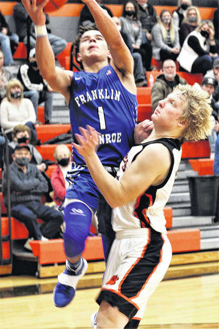 Ky Cool scores on a driving layup for Franklin Monroe in the Jets Cross County Conference win over the Ansonia Tigers.