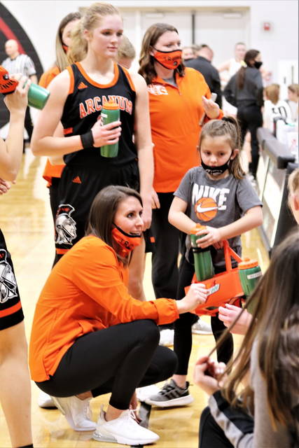 Arcanum coach, Abbey Moore talkes to her team in the Lady Trojans tournament win over Indian Lake.