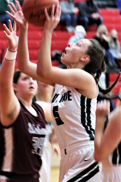 Abbie Yoder powers her way to a score for Greenville in the Lady Wave's tournament win over Urbana.