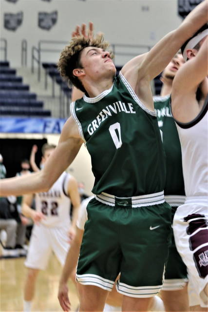 Alex Baumgardner goes strong to the basket in tournament action for the Green Wave.