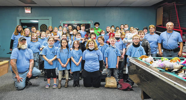 Shown are kids and staff of the Greenville Boys & Girls Club gathered together at this year's Christmas party.